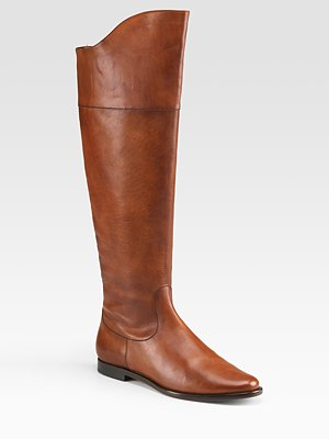 over the knee boots and jeans. in over-the-knee boots,